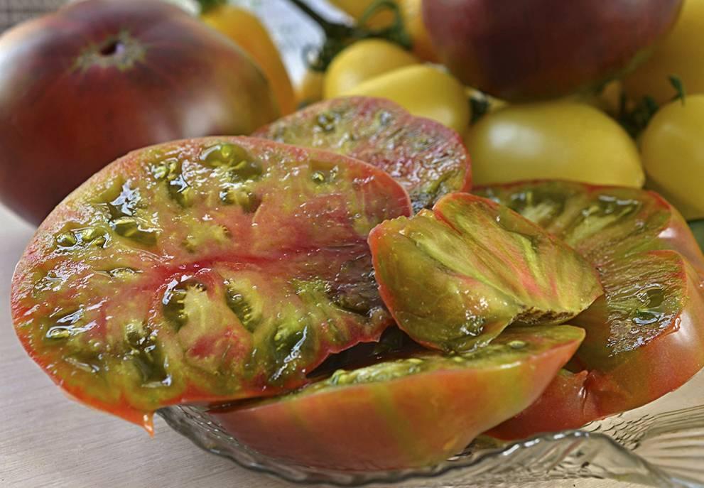 Описание сорта томата черный ананас и особенности выращивания